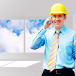 Young architect wearing a protective helmet standing on the buil — Stock Photo #6351952