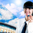 Hapiness Businesswoman standing on the business background — Stok fotoğraf