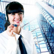 Hapiness Businesswoman standing on the business background — Stock Photo #6351982