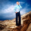 Happy Businesswoman standing with laptop on the mountain under b — Stock Photo #6352004