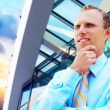 Happiness businessman on the business architecture background — Stock Photo