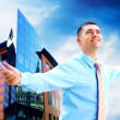 Hapiness Businessman standing on the business background — Stock Photo #6352035
