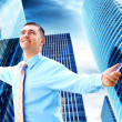 Hapiness Businessman standing on the business background — Foto de Stock