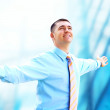 Hapiness Businessman standing on the business background — Stock Photo #6352053