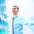 Royalty-Free Stock Photo: Hapiness Businessman standing on the business background