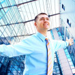 Hapiness Businessman standing on the business background — Stock Photo #6352062