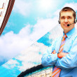 Happiness businessman in headphoness on the business architectur — Stockfoto