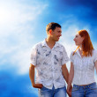 Young love couple smiling under blue sky — Stock Photo #6352133