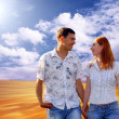 Young love couple smiling under blue sky — Stock Photo #6352134