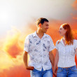 Young love couple smiling under blue sky — Stock Photo #6352142