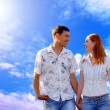 Young love couple smiling under blue sky — Foto de Stock