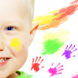 Happiness young smiles boy and color hands — Stock Photo
