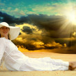 Young beautiful women in white, relaxation at sunny desert — Stock Photo