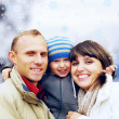 Happy family portrait outdoors smiling. Winter — Stock Photo #6352177