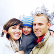 Happy family portrait outdoors smiling. Winter — Stock Photo #6352181