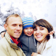 Happy family portrait outdoors smiling. Winter - Stock Photo