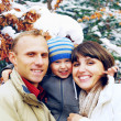 Stock Photo: Happy family portrait outdoors smiling. Winter