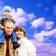 Happy family portrait outdoors smiling with a blue sky — Foto Stock