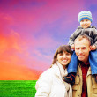 Happy family portrait outdoors smiling with a blue sky — Stock Photo #6352201