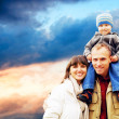 Happy family portrait outdoors smiling with a blue sky — Stock Photo #6352207