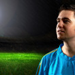 Portrait of Soccer player on the field in night rain - Stockfoto