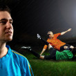 Portrait of Soccer player on the field in night rain — Stok fotoğraf