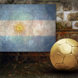 Grunge flag on the wall and ball — Stock Photo #6352459