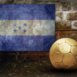 Grunge flag on the wall and ball — Stock Photo #6352486