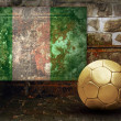 Stock Photo: Grunge flag on wall and ball