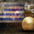 Grunge flag on the wall and ball - Lizenzfreies Foto
