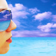 Young girl in Glasses is looking on the tropical sun beach — Stock Photo #6352551