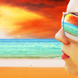Young girl in Glasses is looking on the tropical sun beach — Stock Photo