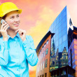 Young architect-woman wearing a protective helmet standing on th — Stock Photo #6352611
