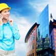 Young architect-woman wearing a protective helmet standing on th — Foto de Stock
