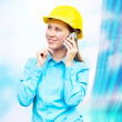 Young architect-woman wearing a protective helmet standing on th — Stock Photo #6352648