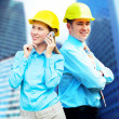 Stock Photo: Young architects wearing protective helmet standing on bui
