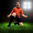 Royalty-Free Stock Photo: Happiness football player after goal on the field of stadium wit