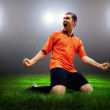 Happiness football player after goal on the field of stadium wit — Stock Photo #6352723