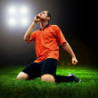 Happiness football player after goal on the field of stadium wit — Stock Photo #6352731