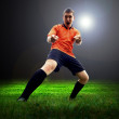 Happiness football player after goal on the field of stadium wit — Stock Photo #6352740