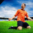 Happiness football player after goal on the field of stadium wit — Stock Photo #6352791