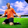 Happiness football player after goal on the field of stadium wit — 图库照片