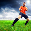 Happiness football player after goal on the field of stadium wit — Stock Photo #6352821