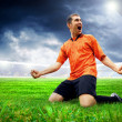Happiness football player after goal on the field of stadium wit — Stock Photo #6352826