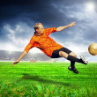 Happiness football player after goal on the field of stadium wit - Stock fotografie