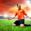 Happiness football player after goal on the field of stadium wit — Stock Photo #6352836