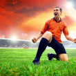 Happiness football player after goal on the field of stadium wit — Stock Photo #6352838