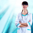 Stock Photo: smiling medical doctor with stethoscope on the hospitals backgro
