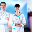 Smiling medical doctor with stethoscope on the hospitals backgro — Stockfoto