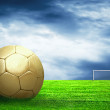Soccer ball on green grass and sky background — Photo